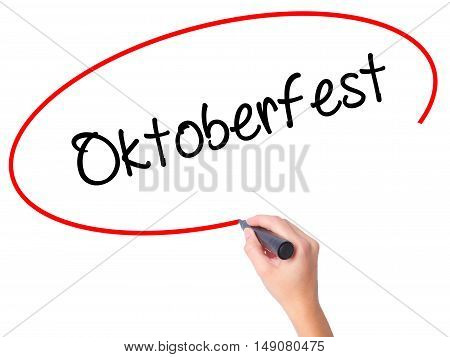 Women Hand Writing Oktoberfest With Black Marker On Visual Screen