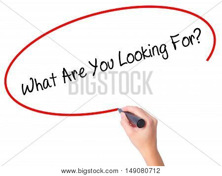 Women Hand Writing What Are You Looking For? With Black Marker On Visual Screen