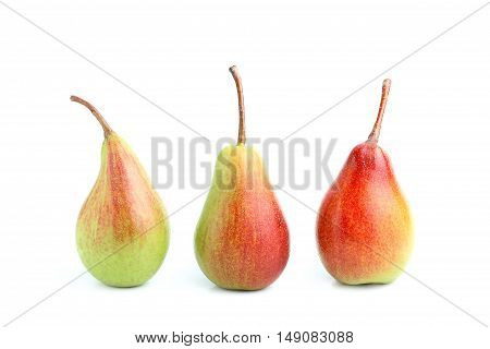 Three ripe pears isolated on white background.