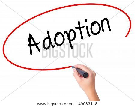 Women Hand Writing Adoption With Black Marker On Visual Screen
