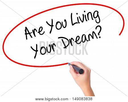 Women Hand Writing Are You Living Your Dream? With Black Marker On Visual Screen
