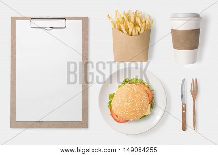 Design Concept Of Mockup Burger, French Fries, Coffee Cup And Clip Board Set Isolated On White Backg