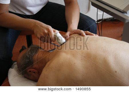 Physiotherapy On Shoulder Of Senior Male