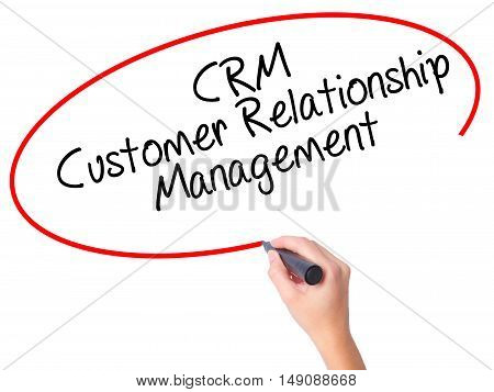 Women Hand Writing Crm Customer Relationship Management  With Black Marker On Visual Screen