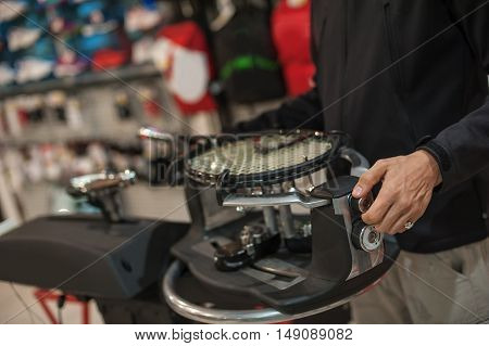 Tennis Stringer Doing Racket Stringing