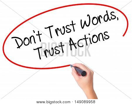 Women Hand Writing Don't Trust Words, Trust Actions With Black Marker On Visual Screen