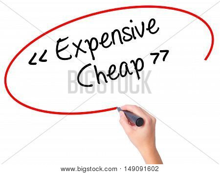 Women Hand Writing Expensive - Cheap With Black Marker On Visual Screen.