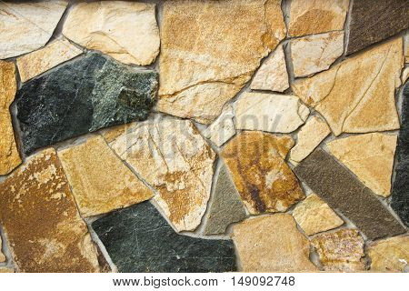 A Wall Of A Wild Multi-colored Natural Stone Texture