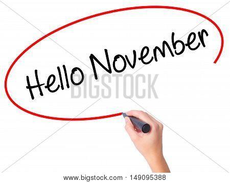 Women Hand Writing Hello November With Black Marker On Visual Screen