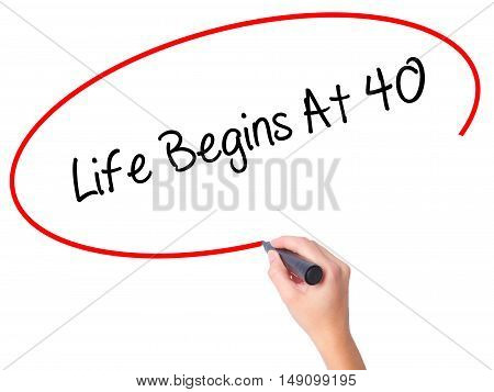 Women Hand Writing Life Begins At 40  With Black Marker On Visual Screen