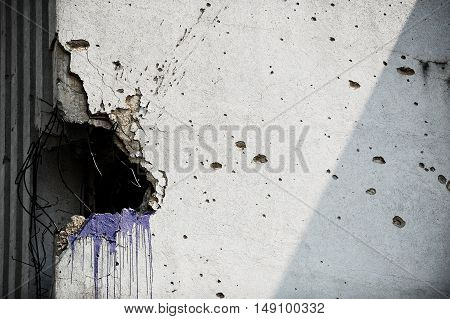 Traces of bullets on a building facade destroyed by war