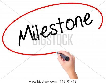 Women Hand Writing Milestone With Black Marker On Visual Screen.