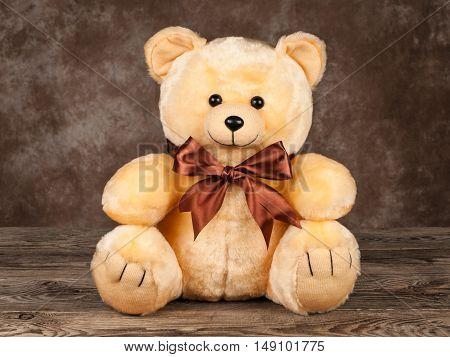 little vintage teddy bear on old boards.