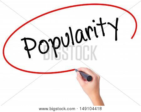 Women Hand Writing Popularity With Black Marker On Visual Screen.