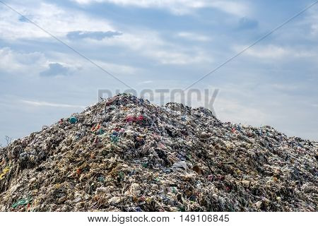 Garbage Dump landscape with trash and blue sky