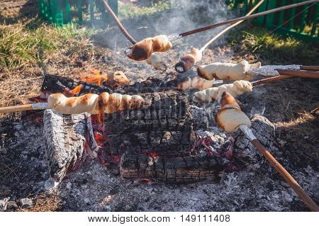 Bread On Sticks Over An Outdoor Campfire