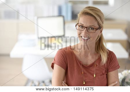 Portrait of attractive businesswoman with eyeglasses