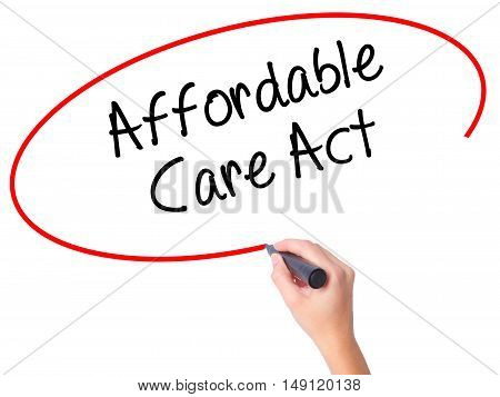 Women Hand Writing Affordable Care Act With Black Marker On Visual Screen