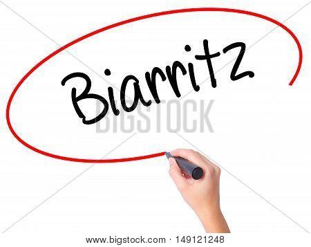 Women Hand Writing Biarritz  With Black Marker On Visual Screen