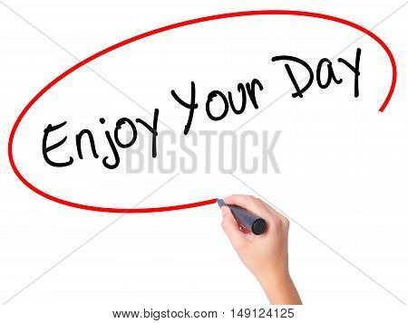 Women Hand Writing Enjoy Your Day With Black Marker On Visual Screen