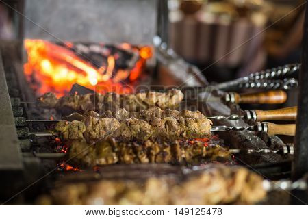 Preparing Grilled Skewed Meat On Bbq In Restaurant