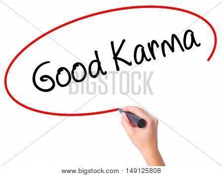 Women Hand Writing  Good Karma With Black Marker On Visual Screen