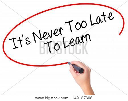 Women Hand Writing Its Never Too Late To Learn With Black Marker On Visual Screen
