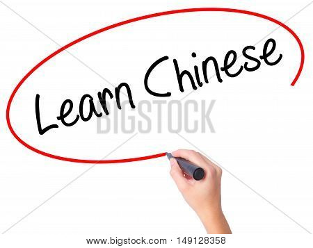 Women Hand Writing Learn Chinese With Black Marker On Visual Screen.