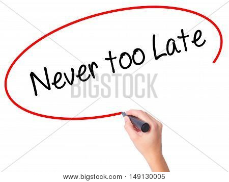 Women Hand Writing Never Too Late With Black Marker On Visual Screen