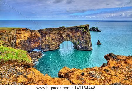 Natural arch of Dyrholaey Peninsula in South Iceland