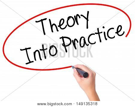 Women Hand Writing Theory Into Practice With Black Marker On Visual Screen