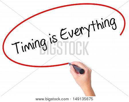 Women Hand Writing Timing Is Everything With Black Marker On Visual Screen