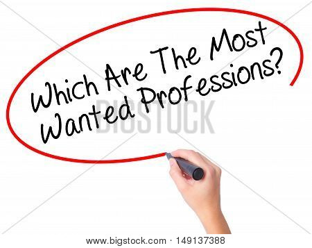 Women Hand Writing Which Are The Most Wanted Professions? With Black Marker On Visual Screen