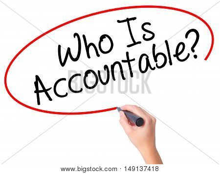 Women Hand Writing Who Is Accountable? With Black Marker On Visual Screen