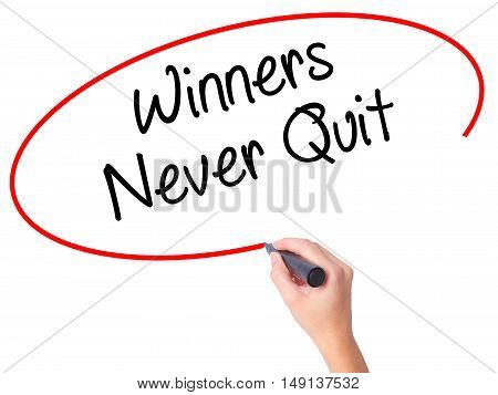 Women Hand Writing Winners Never Quit With Black Marker On Visual Screen