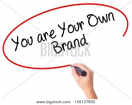 Women Hand Writing You Are Your Own Brand With Black Marker On Visual Screen