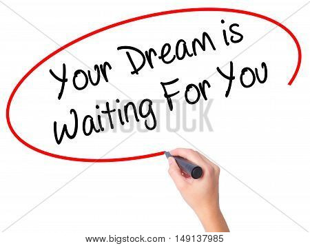 Women Hand Writing Your Dream Is Waiting For You With Black Marker On Visual Screen