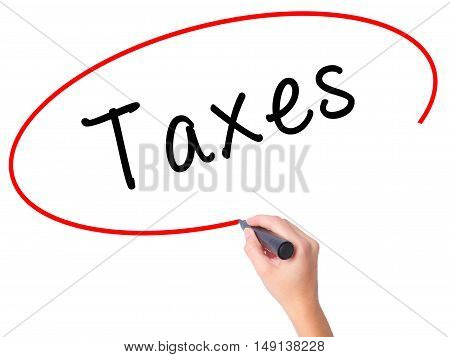Women Hand Writing Taxes With Marker On Transparent Wipe Board