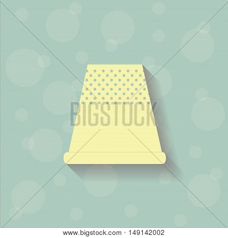 Yellow thimble on the blue background with circles