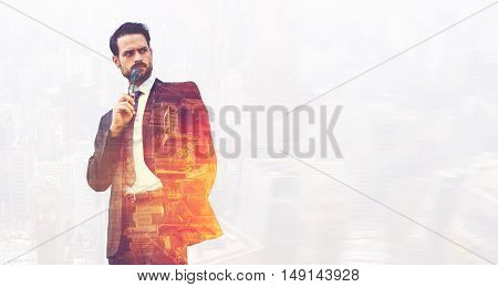 Double exposure of a businessman with angry face is looking away while is standing near copy space for your advertising text message or promotional content. Successful male CEO is thinking about work