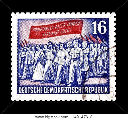GERMAN DEMOCRATIC REPUBLIC- CIRCA 1953 : Cancelled postage stamp printed by German Democratic Republic, that shows Demonstrators.