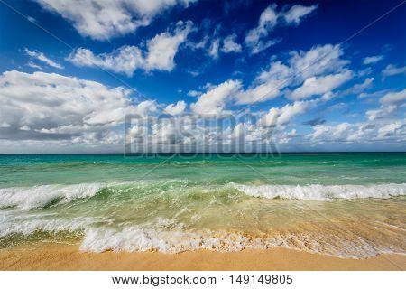 Beach holidays vacation background - beautiful beach and  waves of Caribbean Sea