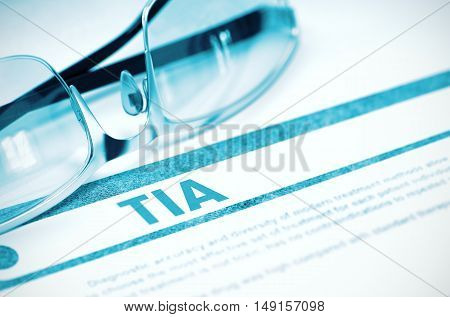 TIA - Transient Ischemic Attack - Printed Diagnosis with Blurred Text on Blue Background with Specs. Medical Concept. 3D Rendering.