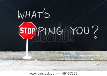 What Is Stopping You Message Written On Chalkboard