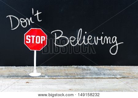 Do Not Stop Believing Message Written On Chalkboard