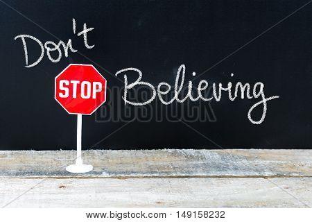 Do Not Stop Believing Message Written On Chalkboard