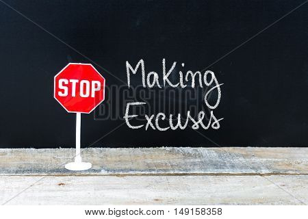 Stop Making Excuses Message Written On Chalkboard