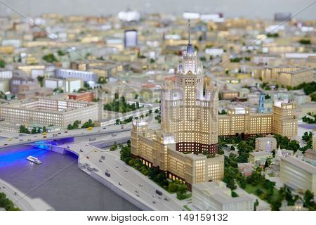 MOSCOW, RUSSIA - DEC 20, 2014: Miniature of Stalin skyscraper at Kotelnicheskaya embankment on the left bank of the Moskva River at VDNKH exhibition.