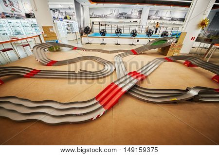 MOSCOW, RUSSIA - APR 02, 2016: Race track for toy cars in recreational zone of Aviapark shopping center. Aviapark total area of 390 000 sq. m., shopping area - 230,000 sq.m.