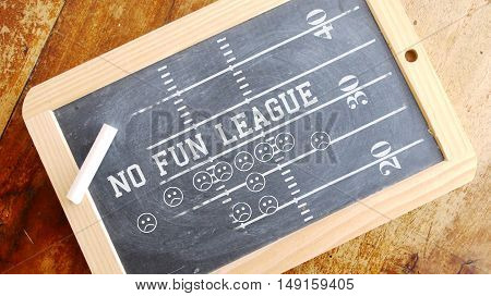 No fun league. American football scheme. Chalk on Blackboard